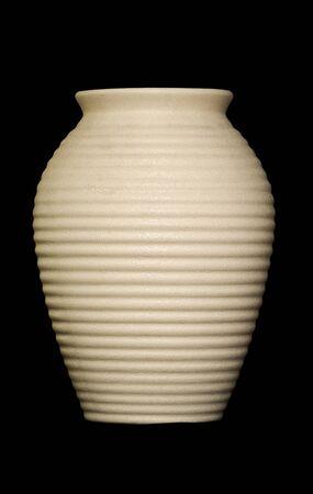 ceramic jar on black background