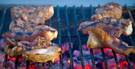 barbecue grill pork on fire