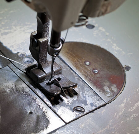 stitching machine: zig-zag stitching machine for footwear manufacturing Stock Photo