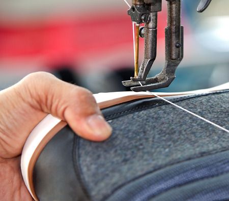 shoe stitching process in footwear industry Stock Photo