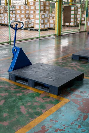 hand forklift and plastic pallet in warehouse