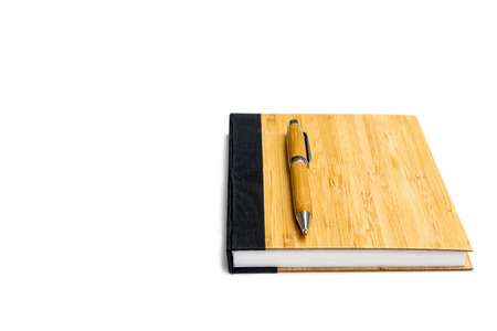 brown diary book and  pen with wood texture design