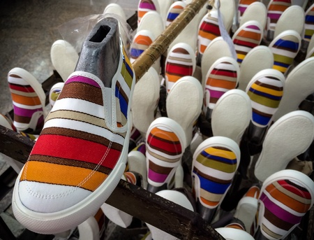 canvas: Colorful sneakers shoe in footwear production line Stock Photo