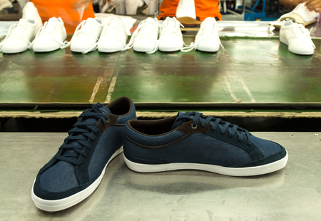 canvas sneaker shoe in a footwear factory line