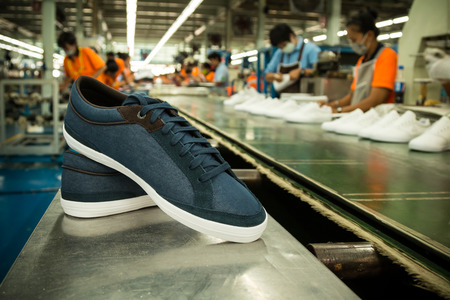 canvas sneaker shoe in a footwear factory line