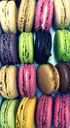 French sweet delicious macaroons variety in rows