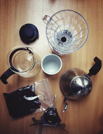 with coffee maker: Coffee maker equipment on kitchen table