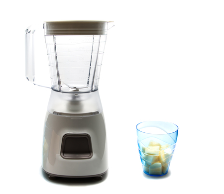 electric blender as kitchen equipment and glass of slide apple isolated on white Stock Photo