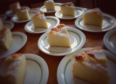 Butter cake with coconut topping prepared on table Stock Photo