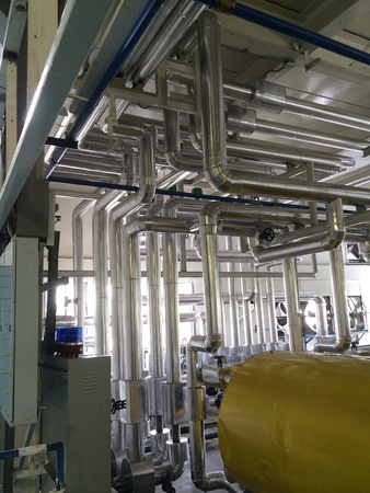 Pipeline of industrial zone where supply hot power energy including valves and gauges