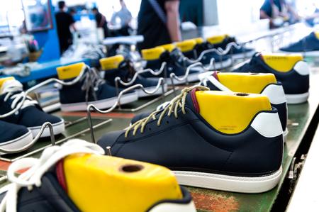 shoe making production line in footwear industry Stock Photo