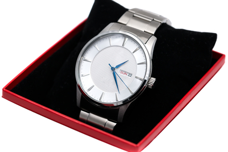 silver wrist watch in a red box