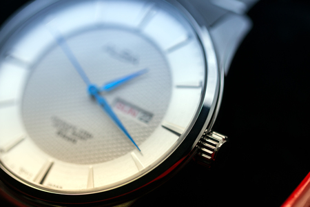 hands  hour: shallow focus of silver wrist watch in a box