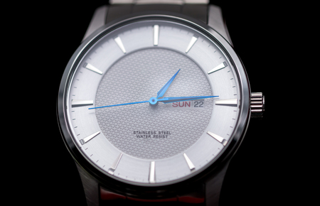 closeup of fashion silver wristwatch display on black background Stock Photo