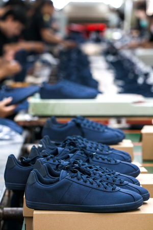 worker making shoes in  production line conveyor