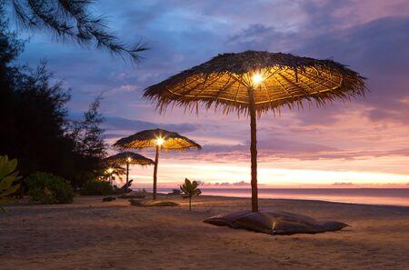Sunset and umbrella on beach  Phang Nga, Thailand