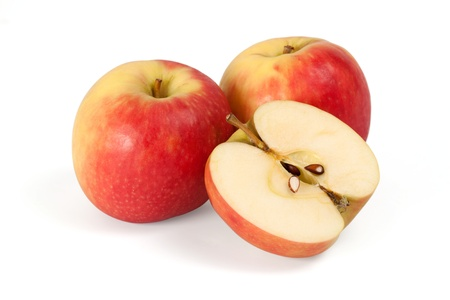 Two apples and half apple sliced on white background