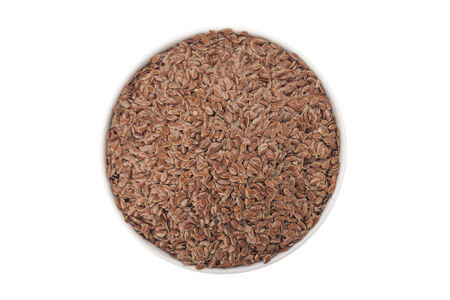 Brown Linseed or Flax seed isolated on white background with clipping path  photo