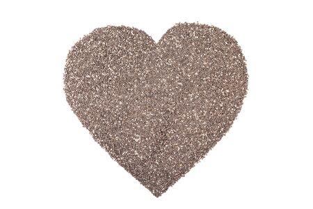 hispanica: heart shape of chia seeds or salvia hispanica isolated on white background