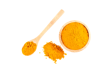 peppery: turmeric powder in wooden bowl and wooden spoon isolated on white background Stock Photo