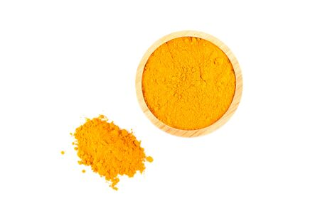 peppery: turmeric powder in wooden bowl isolated on white background Stock Photo