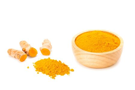 peppery: Turmeric rhizome and turmeric powder in wooden bowl isolated on white background
