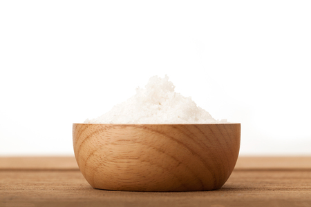 Front view angle Sea salt in wooden bowl on wood background Stock Photo