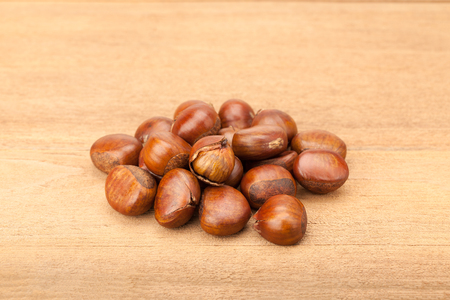 heap of chestnut on wood background