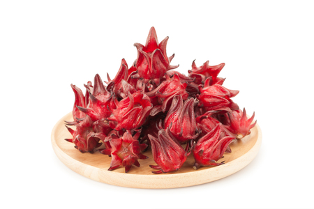 red roselle wooden plate isolated on white background with clupping path and soft shadow
