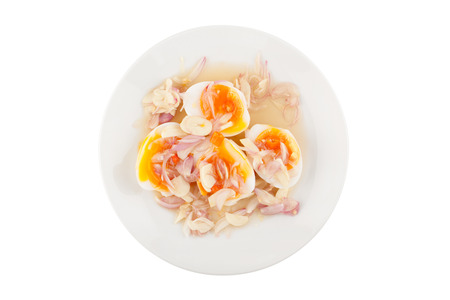 Top view angle soft boiled eggs spicy salad on white ceramic plate isolated on white background with clipping path