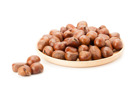 chestnut in wooden plate isolated on white background with clipping path and soft shadow