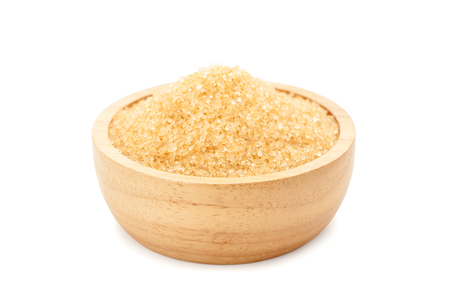 raw organic cane sugar, brown sugar in wooden bowl isolated on white background with clipping path and soft shadow