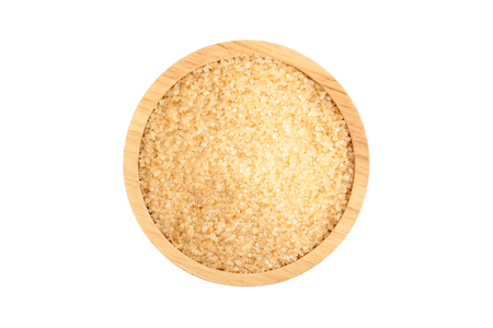 top view angle of raw organic cane sugar, brown sugar in wooden bowl isolated on white background with clipping path Фото со стока