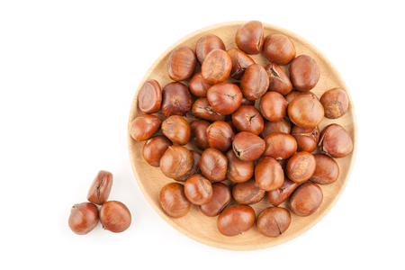 Top view angle of chestnut in wooden plate isolated on white background with clipping path Zdjęcie Seryjne