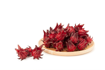red roselle wooden plate isolated on white background with clipping path and soft shadow Stock Photo