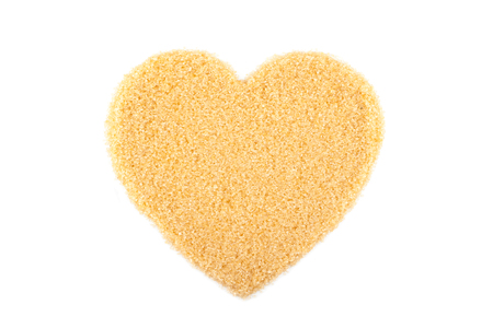 Heart shape of raw Organic Cane Sugar, Brown sugar isolated on white background