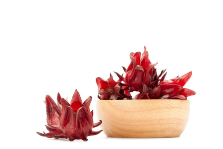 front view angle of red roselle wooden bowl isolated on white background Фото со стока