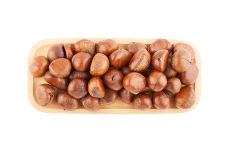 Top view angle of chestnut in wooden plate isolated on white background with clipping path Фото со стока
