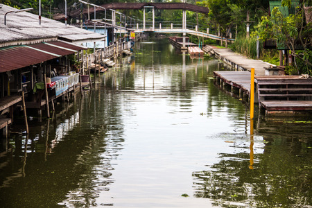 Thailand canal at twilight in rural commute .