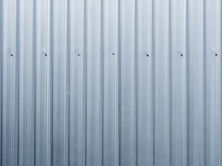 This is the corrugated iron wall of factory . Use for background