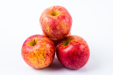 Image of group of red apples in white background. Good for health . Stock Photo