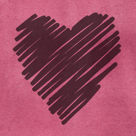 bas relief: Bas relief of heart doodle on pink grained background