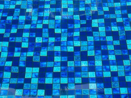 distort: pattern of blue tiles in swimimg pool Stock Photo
