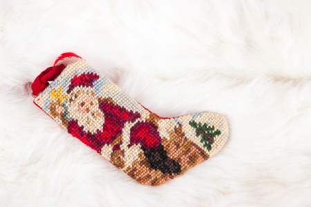 Christmas cross stitch stocking on white fur , use for background photo
