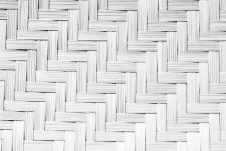 Texture of handmade basket in black and white color . made from bamboo . use for background