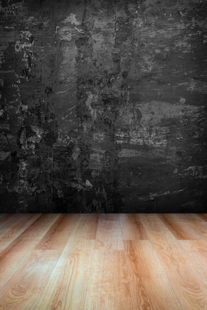 vanishing point: Dark grey grungy concrete wall and wooden floor  use for background