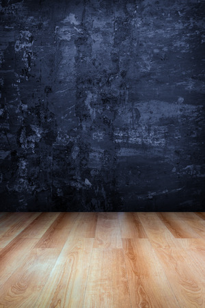 Dark blue grungy concrete wall and wooden floor  use for background