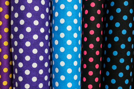 textile image: Rolls of colorful fabric by shallow depth of field  focus Stock Photo
