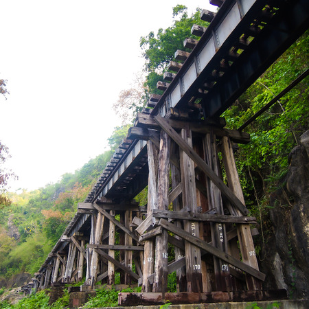 infra construction: old wood structure of dead railways bridge important landmark and destination of world war II history in kanchanaburi thailand and now is famous visiting point of visitor in thailand