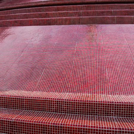 watertight: Kanchanaburi, Thailand - March 5, 2011 : Glossy red small tiles decorated on surface of the pagoda of Sunanthawararam Temple
